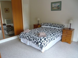 Bedroom at The Pines luxury holiday apartment